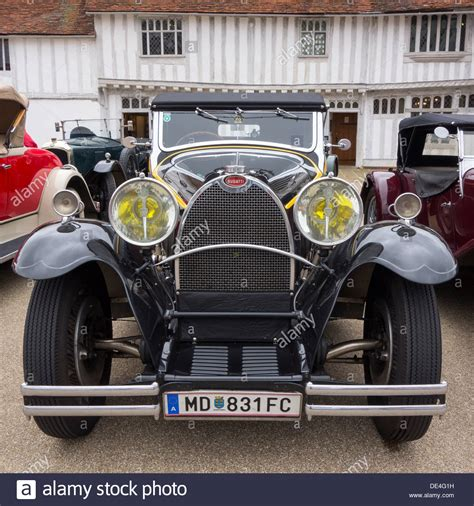 A Front View Of A Classic Bugatti Grand Sport Road Car