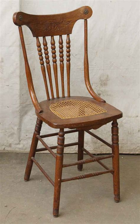 pair of carved wood chairs with wicker seat olde things