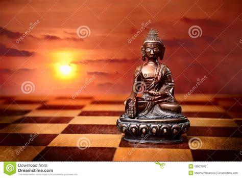 Bronze Buddha On Chess Desk Floor Stock Photo  Image Of