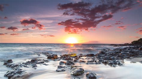 wallpaper beach sunset rocks sunrays seashore