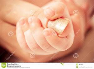 Baby's Hand Keeping Mother Finger Stock Photos