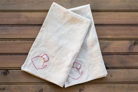 turn plain kitchen towels  fancy embroidered linens hgtv