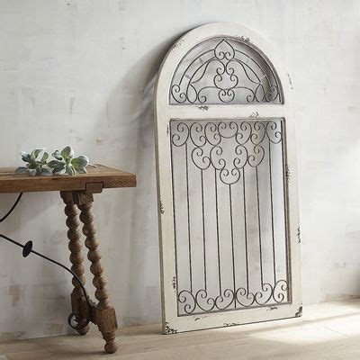 white antiqued arch wall decor spanish style wooden