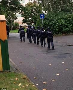 German town on lockdown as armed police hunt man suspected ...