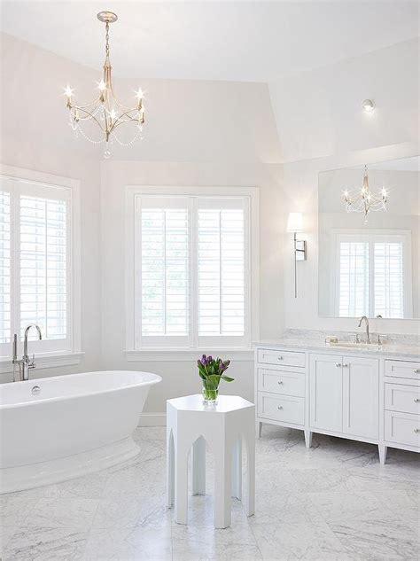 Kitchen Bay Window Seating Ideas - nickel and beaded chandelier over tub transitional bathroom benjamin moore paper white