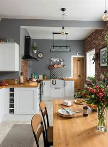 shaker, style, kitchen, with, grey, walls, , a, wooden, dining, table, , wooden, worktops, and, industrial