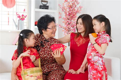 New Celebrate Family Friends Life: Asian Family Celebrate Chinese New Year At Home. Stock