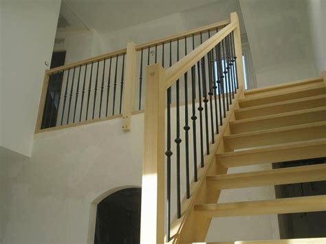 escalier bois avec re fer forge wordmark