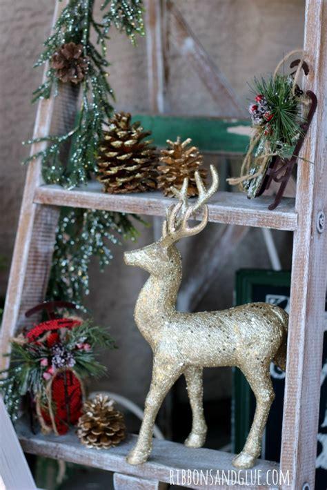 rustic christmas decorations displayed   vintage ladder