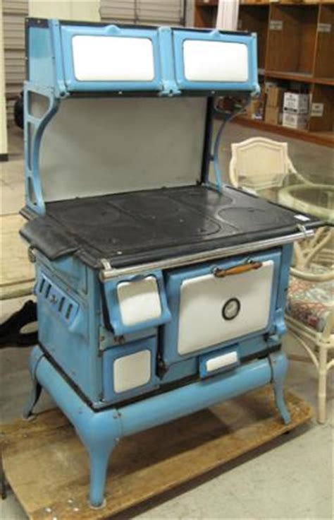 375: A CAST IRON WOOD BURNING COOK STOVE, Montgomery W
