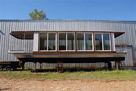 metroship modern glass houseboat inspired  phillip