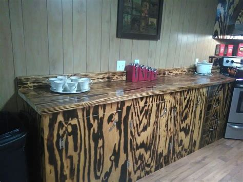 cabinets  countertops   burnt pine wood