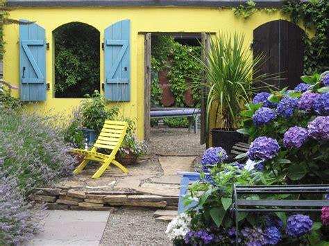 italian courtyard garden design ideas mediterranean inspired courtyards outdoor spaces patio ideas decks gardens hgtv