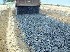 dump truck spreading rock - YouTube