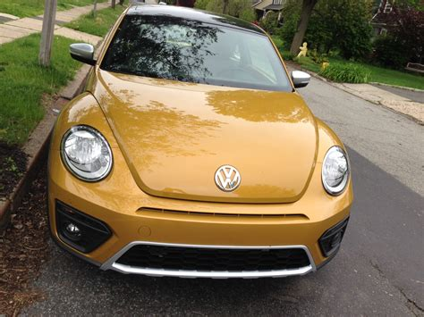 gold volkswagen beetle vw fixed the problem of dirty backup cameras with this