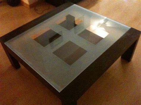 canapé cuir vert table basse roche bobois
