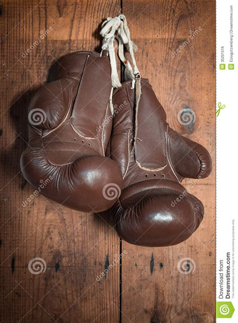 boxing gloves hanging  wooden wall stock photo