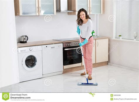 kitchen floor cleaning happy cleaning holding mop stock photography 5611