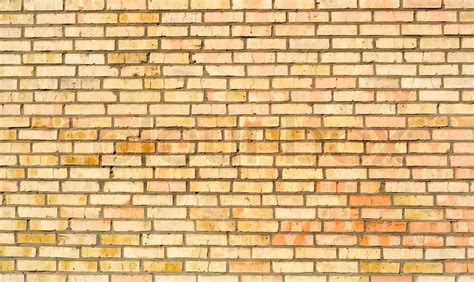 yellow red brick wall background many old bricks