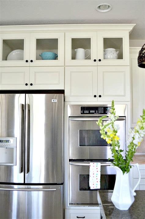 kitchen cabinets with glass on top how to add glass inserts into your kitchen cabinets