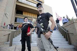 Texas Open Carry demonstrators gathered on the steps of ...