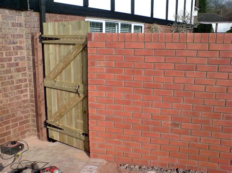 brick wall with gate kingfisher paving construction construction landscaping