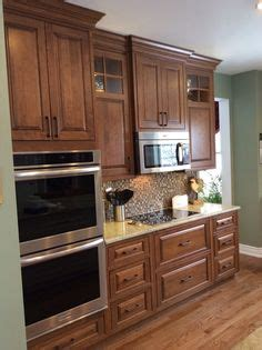 images of kitchen cabinet shiloh polar white on perimeter and silas with black stain 4632
