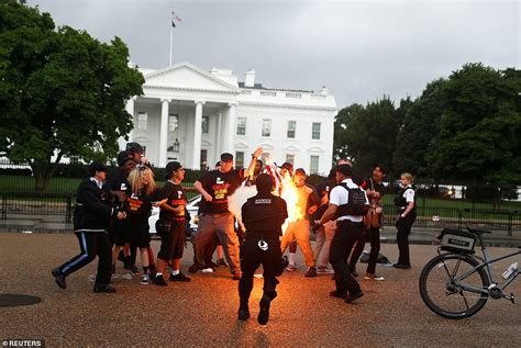 white house protest activist gregory johnson and protesters burn a flag
