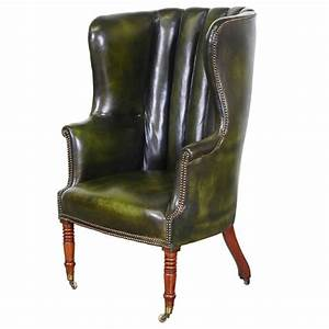 Vintage green leather high back wing chair at 1stdibs for Chair back covers for leather chairs