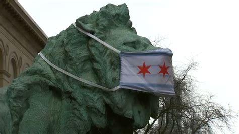 chicago art institute lion statue  face mask stolen