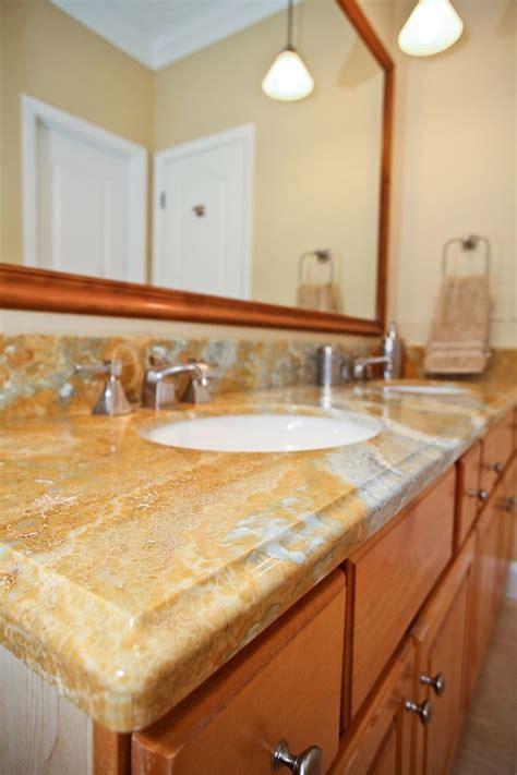 tan white grey granite bathroom countertop  white