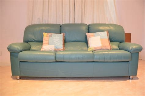teal green leather sofa