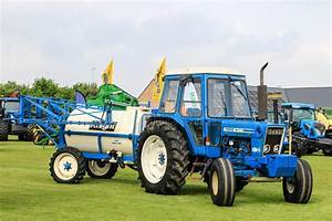 Old Blue Ford 7600 Tractor Pulling A Knight Crop Sprayers
