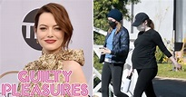 Pregnant Emma Stone pictured cradling baby bump as she ...