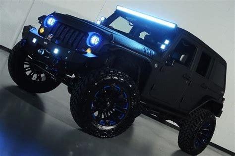 4 door jeep wrangler jacked up 2015 jeep wrangler unlimited rubicon kevlar paint lift kit