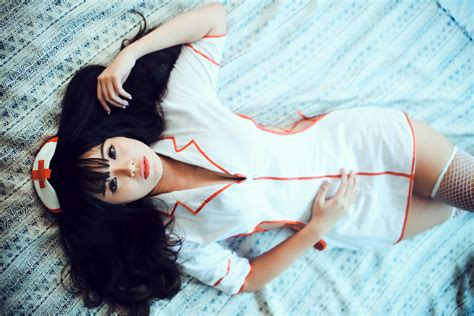 model laying  bed  nurse lingerie outfit image
