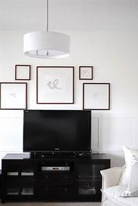 Flourish design style framing a tv with gallery wall