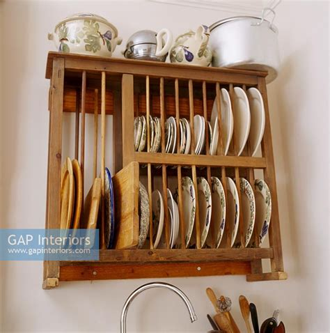 gap interiors wooden wall mounted plate rack image   photo  johnny bouchier
