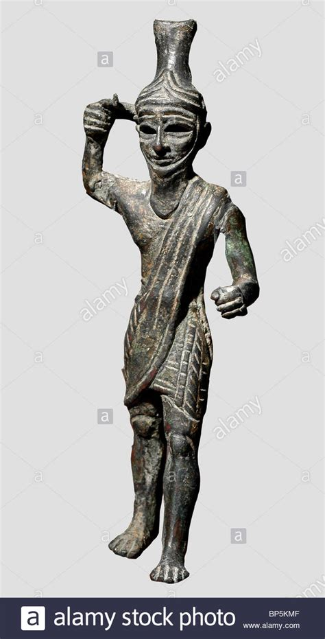 figurine   storm god baal  figurine  covered