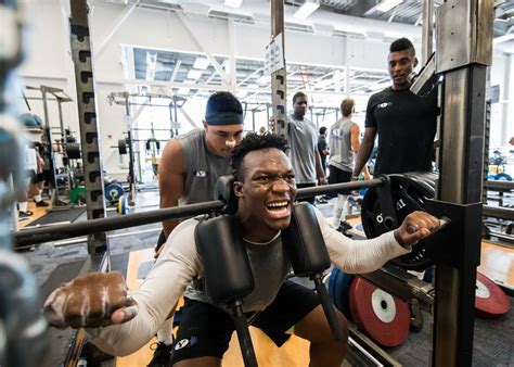 byu football players balancing weightlifting game prep