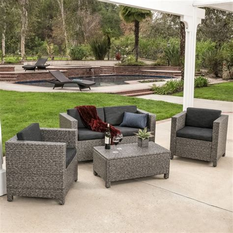 black wicker sofa outdoor sitting area transitional porch
