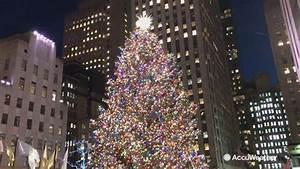 Rockefeller Center Christmas tree lights up for holidays ...