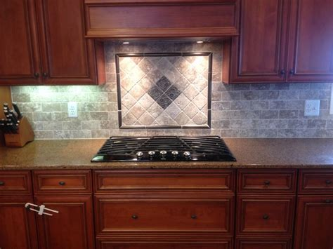 tile backsplash  mosaic design  cooktop