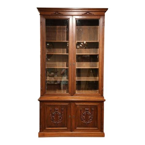 tall early  century french carved walnut bookcase