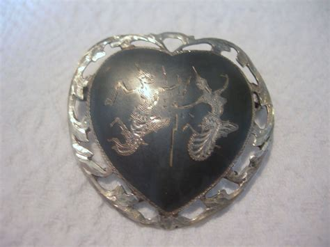 Vintage Nielloware Heart Shaped Brooch From Dorothysbling. Ring Band Designs. Woman Black Watches. Gem Stone Bracelet. Anniversary Bracelet. Tag Watches. Bangle Necklace. Multi Bangle Bracelets. Precious Stone Earrings