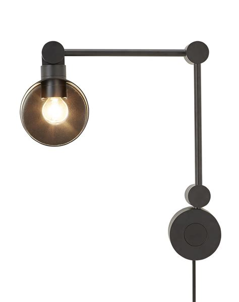 boom wall light with black by tom dixon