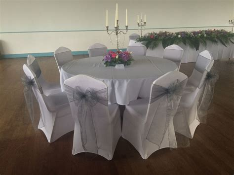 wedding chair covers swansea chair covers and silver organza sashes at a wedding