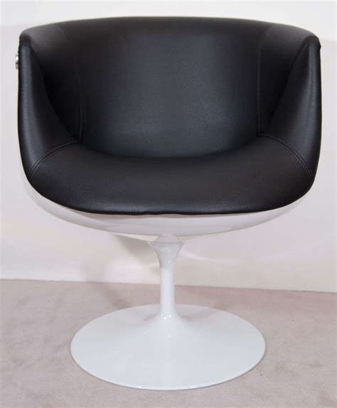 a mid century pair of half egg tulip swivel chairs at 1stdibs