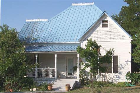 frame house   blue metal roof  built