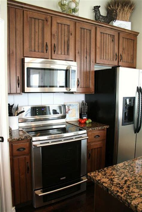 kitchen cabinets with black appliances 46 best images about maple cabinets on stains Maple